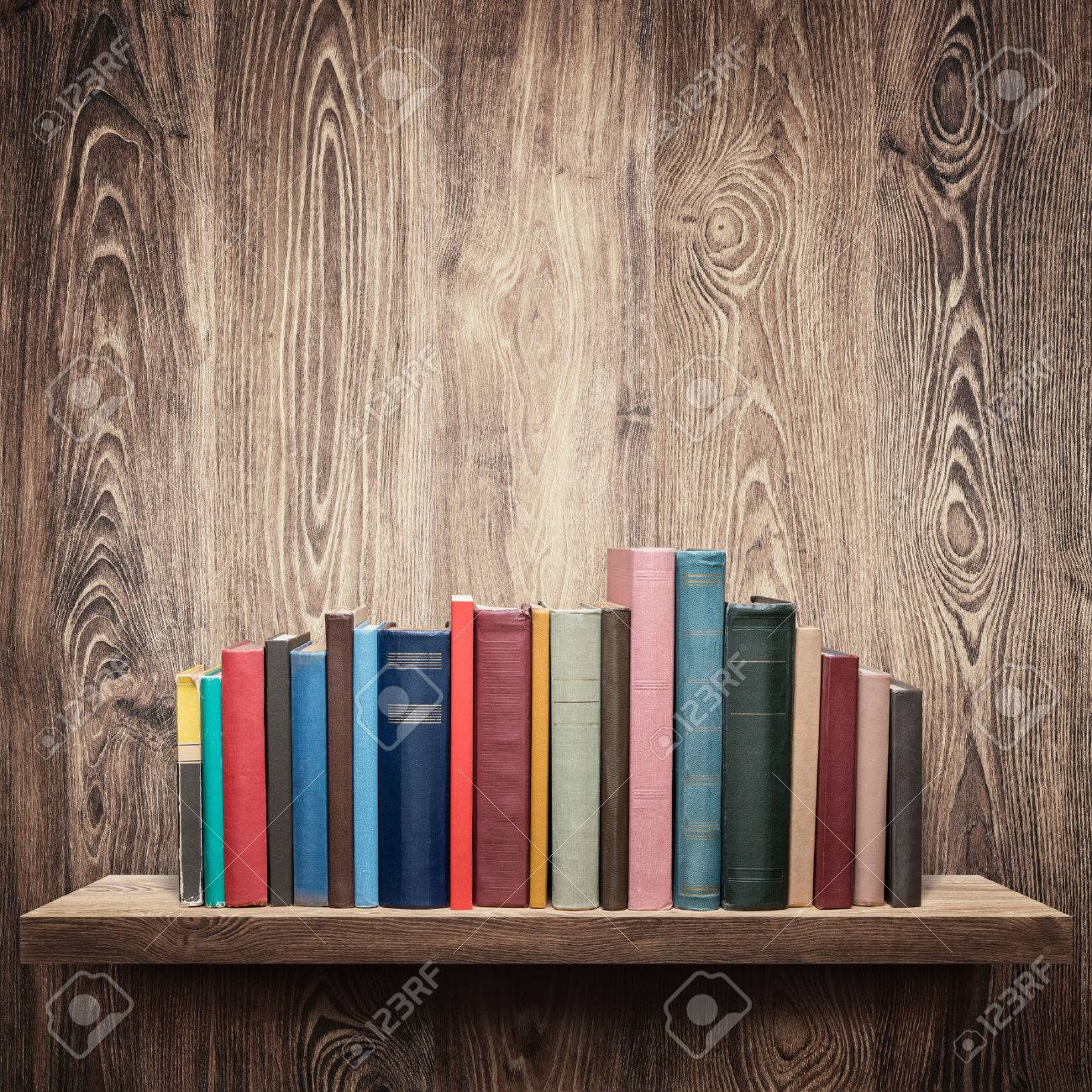 Old books on a wooden shelf. Stock Photo - 32448775