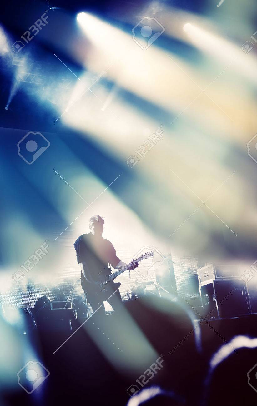 Rock concert stage. Guitarist playing on electric guitar. Stock Photo - 32450648
