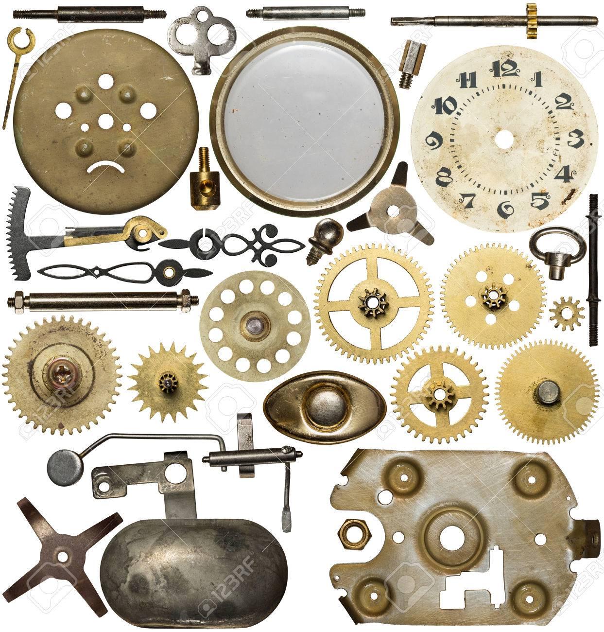 Clockwork spare parts. Metal gear, cogwheels, dial. Stock Photo - 34178876