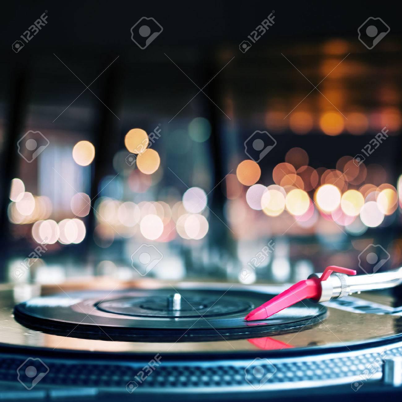 Vinyl record spinning on DJ turntable Stock Photo - 35064773