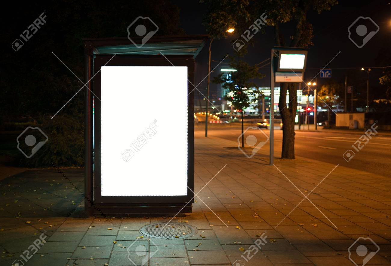 Blank bus stop advertising billboard in the city at night. Stock Photo - 44384007