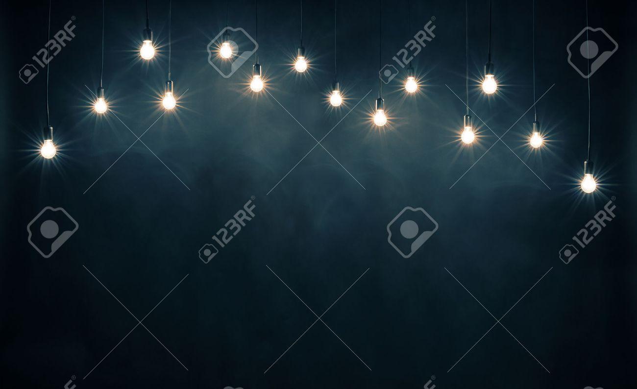 Light bulbs on dark blue background Stock Photo - 44384019