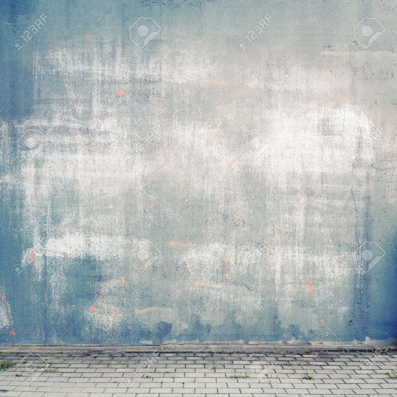 Urban background. Grunge obsolete street wall and pavement. Stock Photo - 44384506