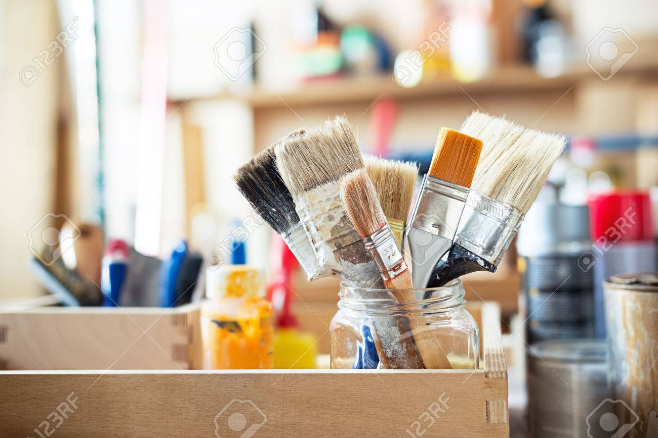 Paint brushes and crafting supplies on the table in a workshop. Stock Photo - 44384575