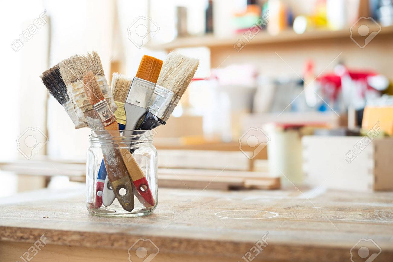 Paint brushes on the table in a workshop. Stock Photo - 44384801