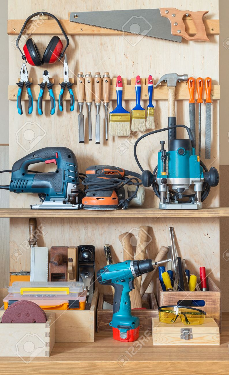 Workshop tool board with various hand tools for repairing and woodworking. Stock Photo - 44384804