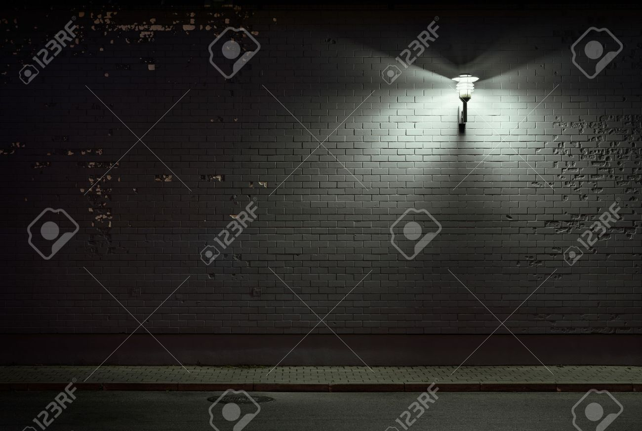 Urban background. Brick wall under the lamp light at night. Stock Photo - 44384898