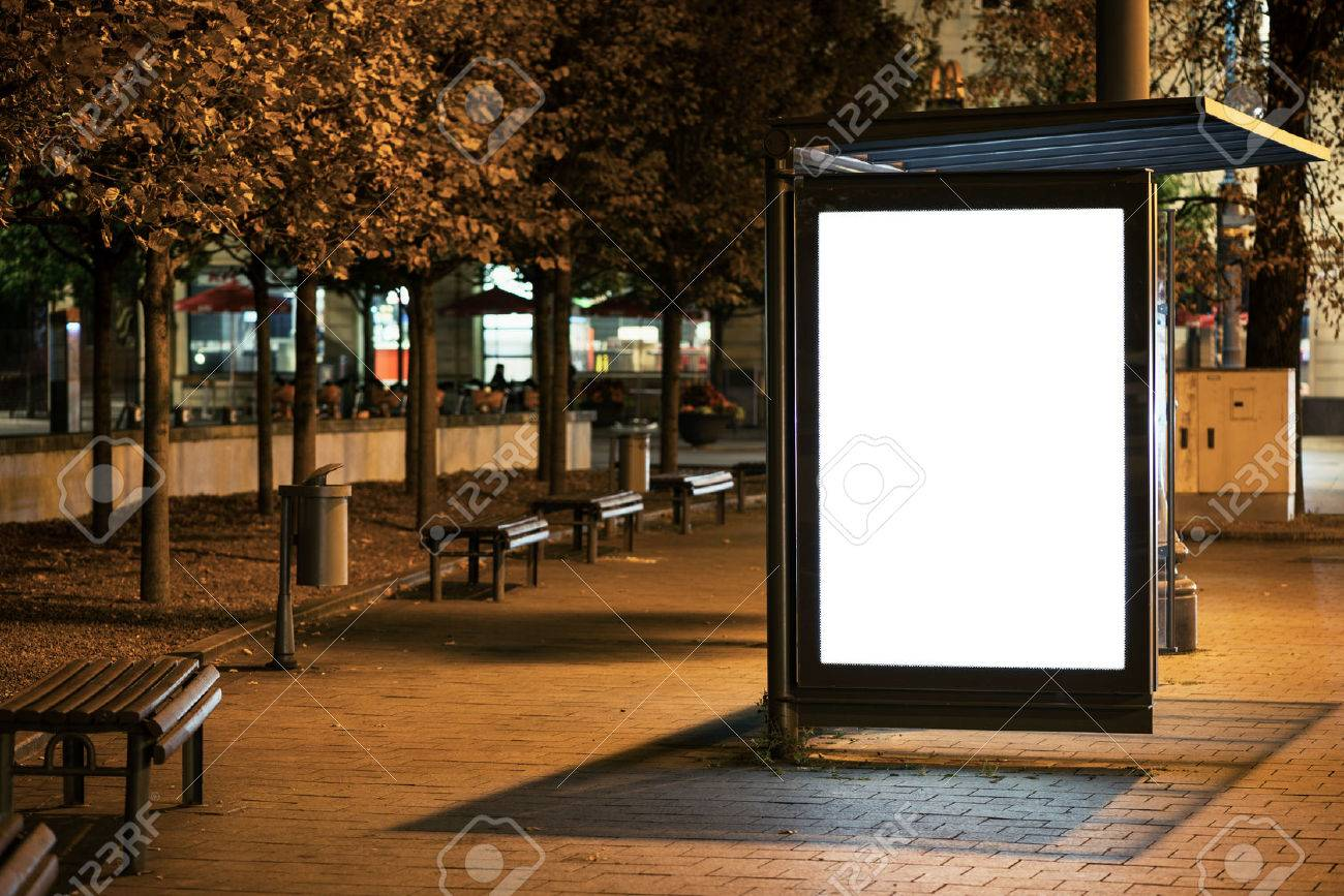 Blank bus stop advertising billboard in the city at night. Stock Photo - 48054369