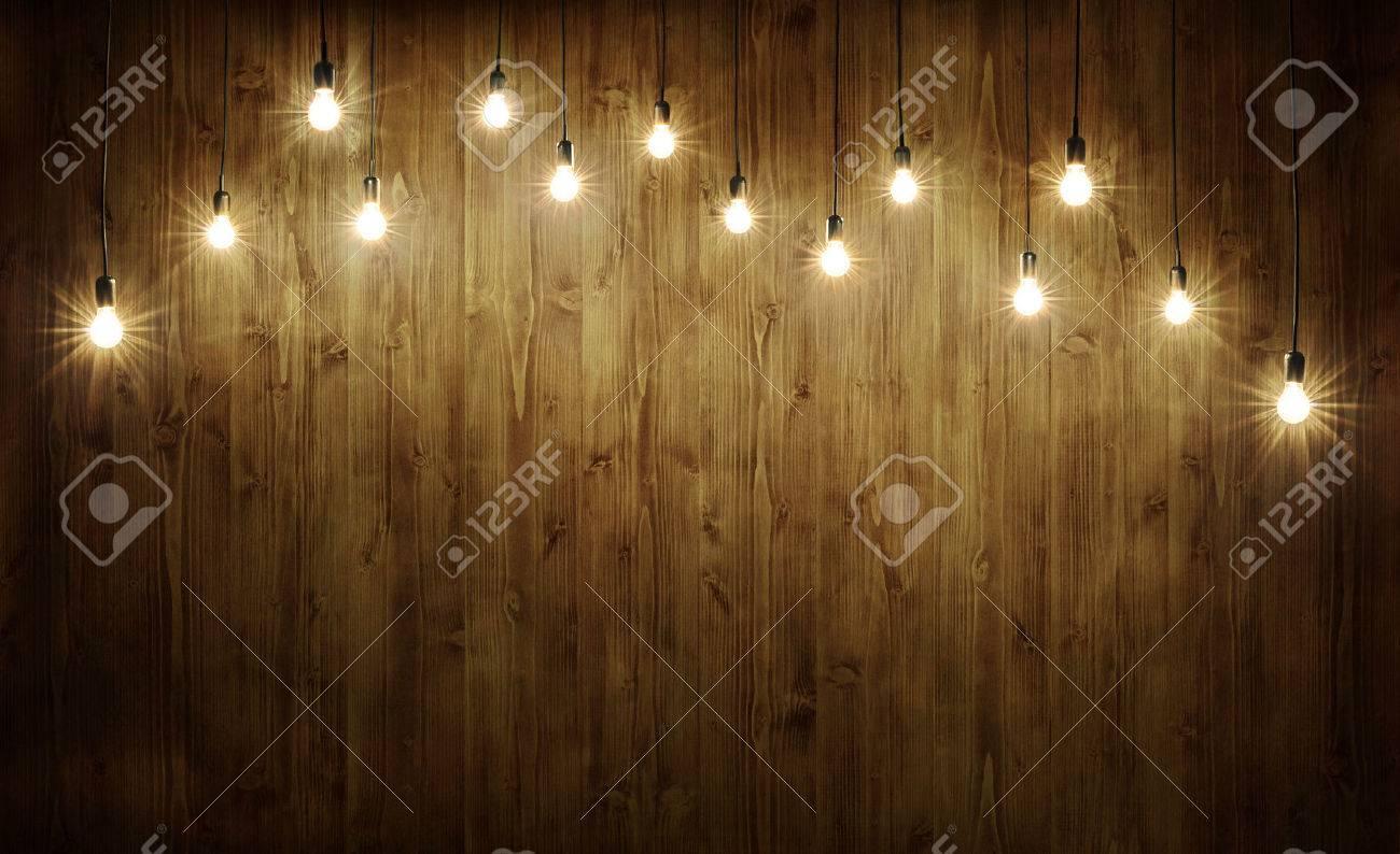 Light bulbs on dark wooden background Stock Photo - 50648084