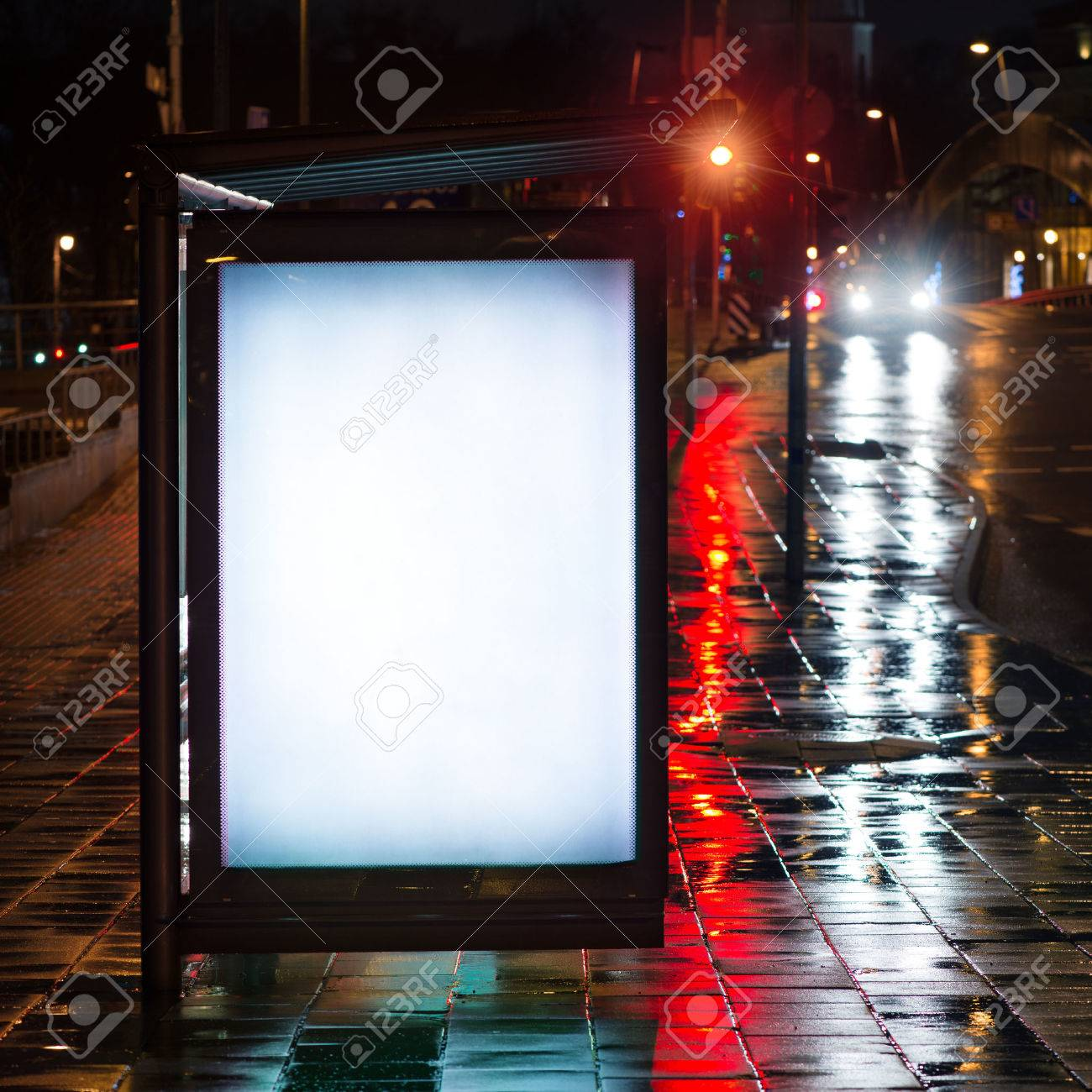 Blank bus stop advertising billboard in the city at night. Stock Photo - 53616418