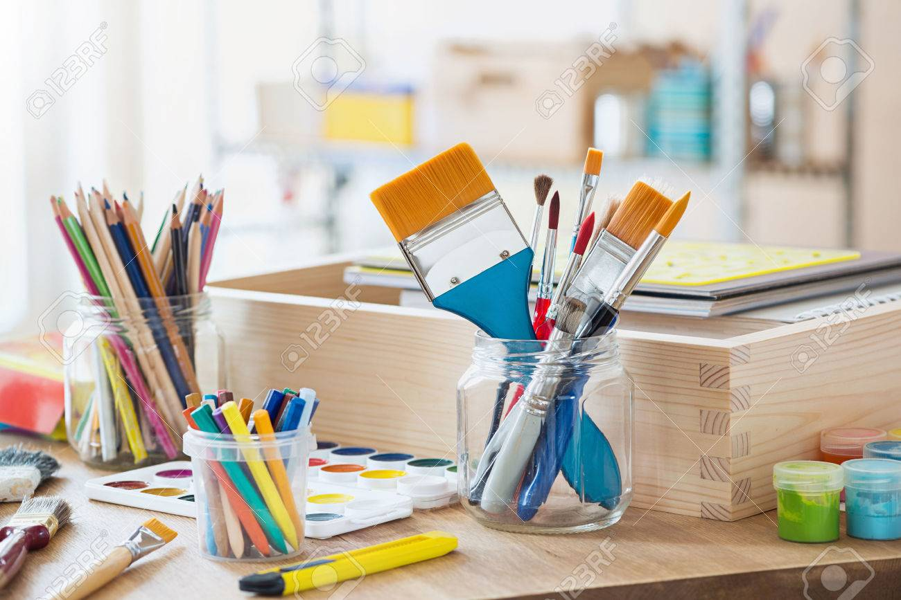 Paint brushes and crafting supplies on the table in a workshop. Stock Photo - 61093000