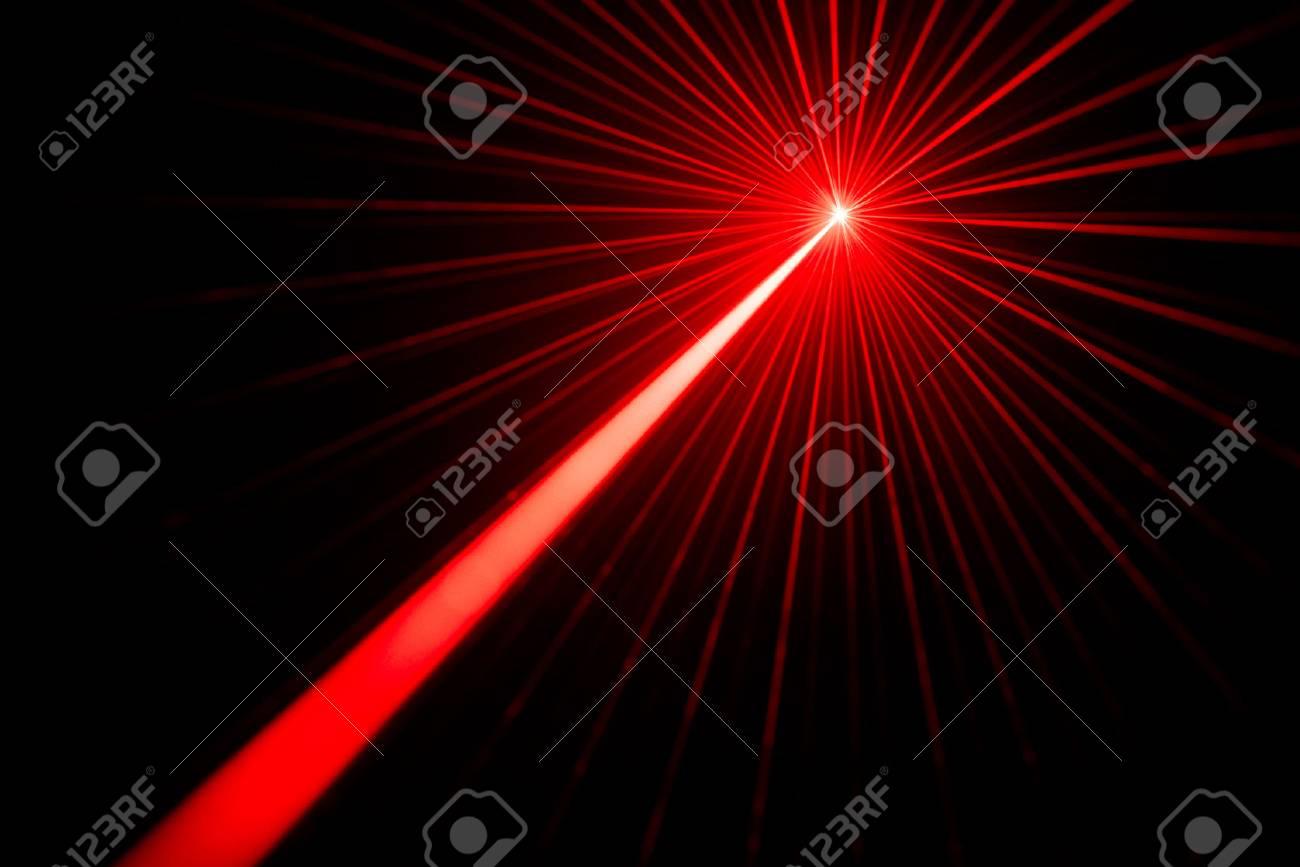 Red laser beams light effect on black background photo. - 87902224