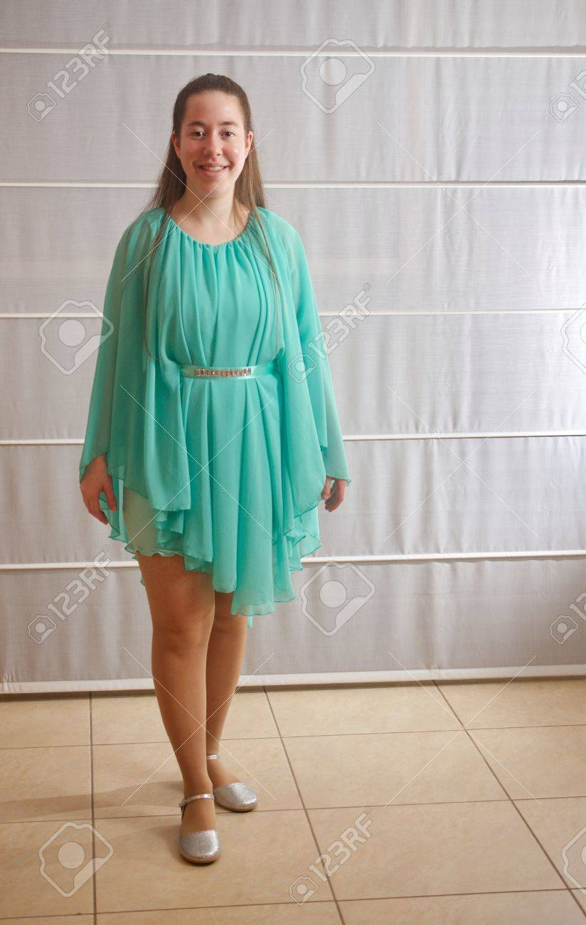 Young Woman All Dressed Up In A Teal Dress For Her Sweet Sixteen ...