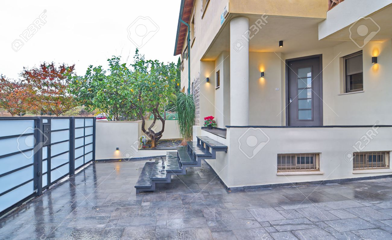 Entrance To A Modern Mediterranean House With Metal And Stone Elements Stock Photo