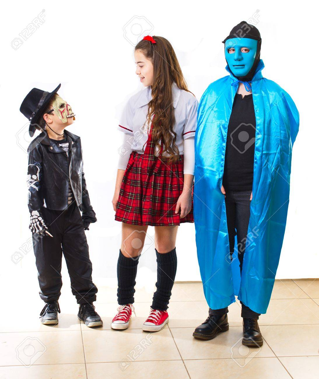 Stock Photo - Three siblings dressed up for Halloween / Purim as a 60u0027s college girl a zombie and a blue man  sc 1 st  123RF.com & Three Siblings Dressed Up For Halloween / Purim As A 60u0027s College ...