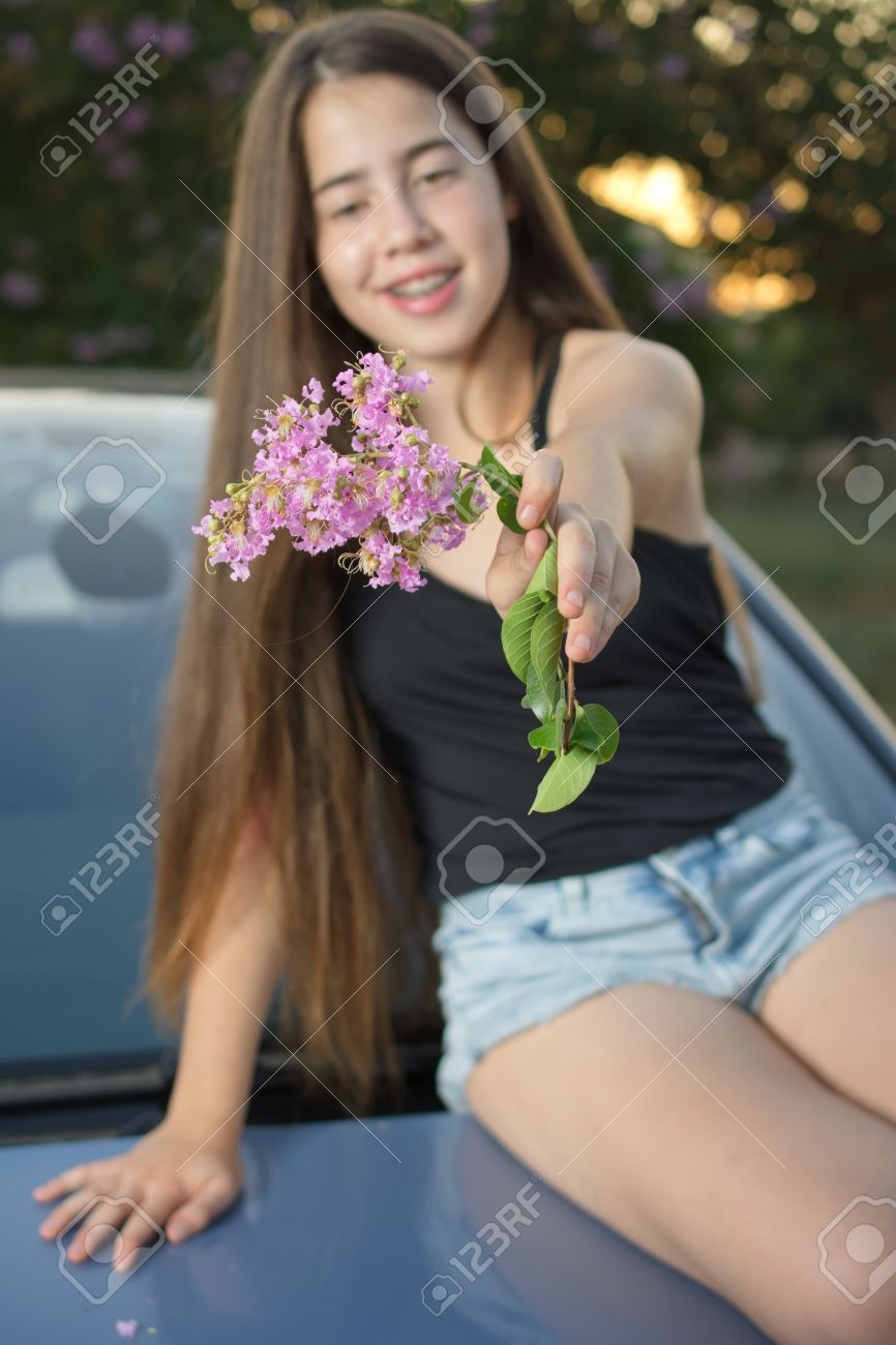 A 13 Year Old Teenage Girl With Braces On Her Teeth Sitting On Stock Photo Picture And Royalty Free Image Image 42855026