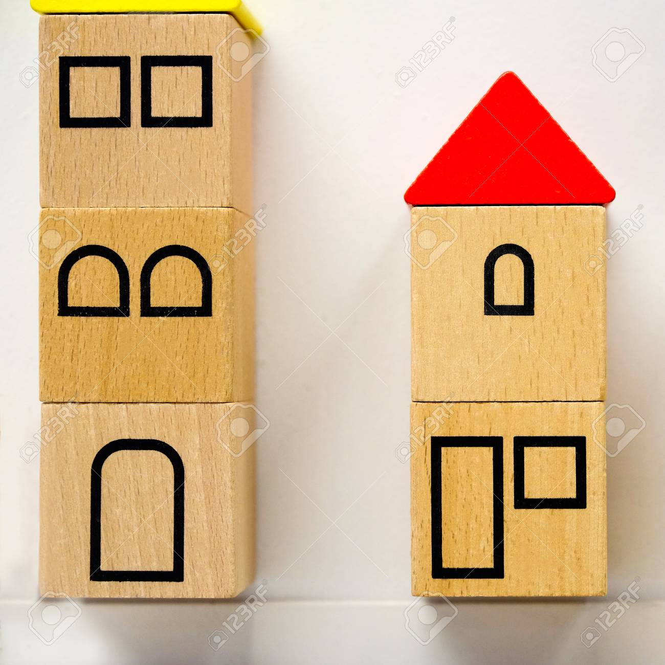 Small Toy Houses Made Of Wooden Blocks With Painted Windows