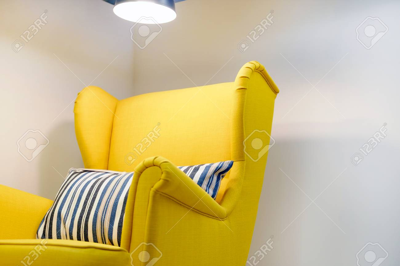 Yellow Myagkoe Chair With Cushion High Back Reading Lamp Above Her