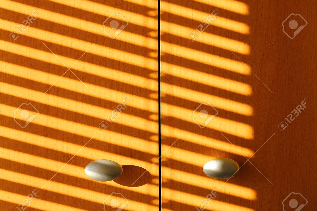 The Shadow Of The Sun Blinds On The Doors Of Wardrobe Stock Photo Picture And Royalty Free Image Image 118122551