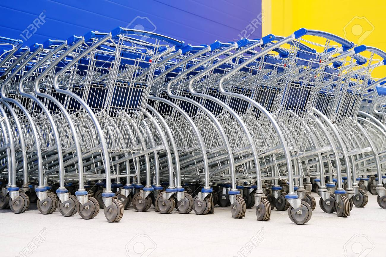 Baskets on wheels. Parking baskets for buyers of supermarkets and hypermarkets - 121638265