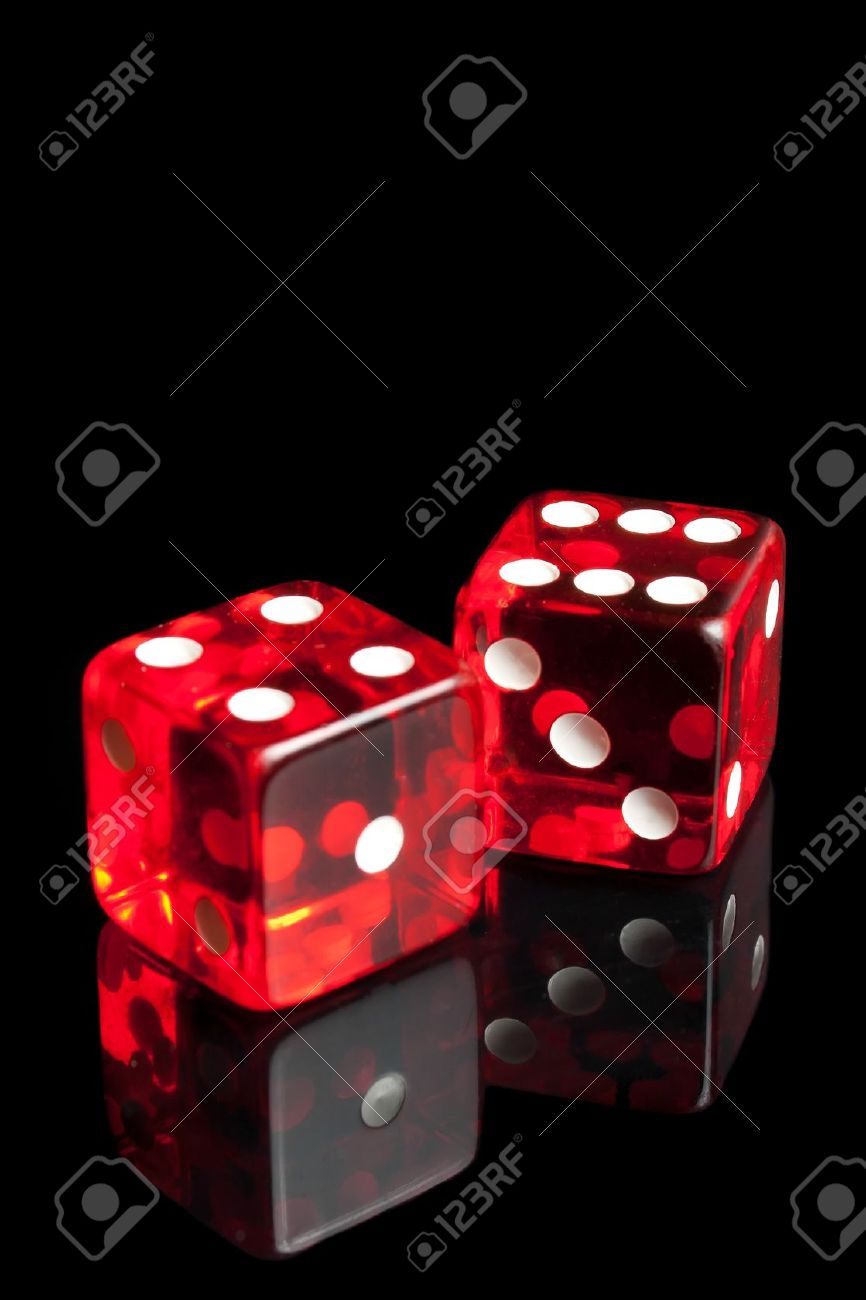 detail of red dice on transparent black background - 11586368