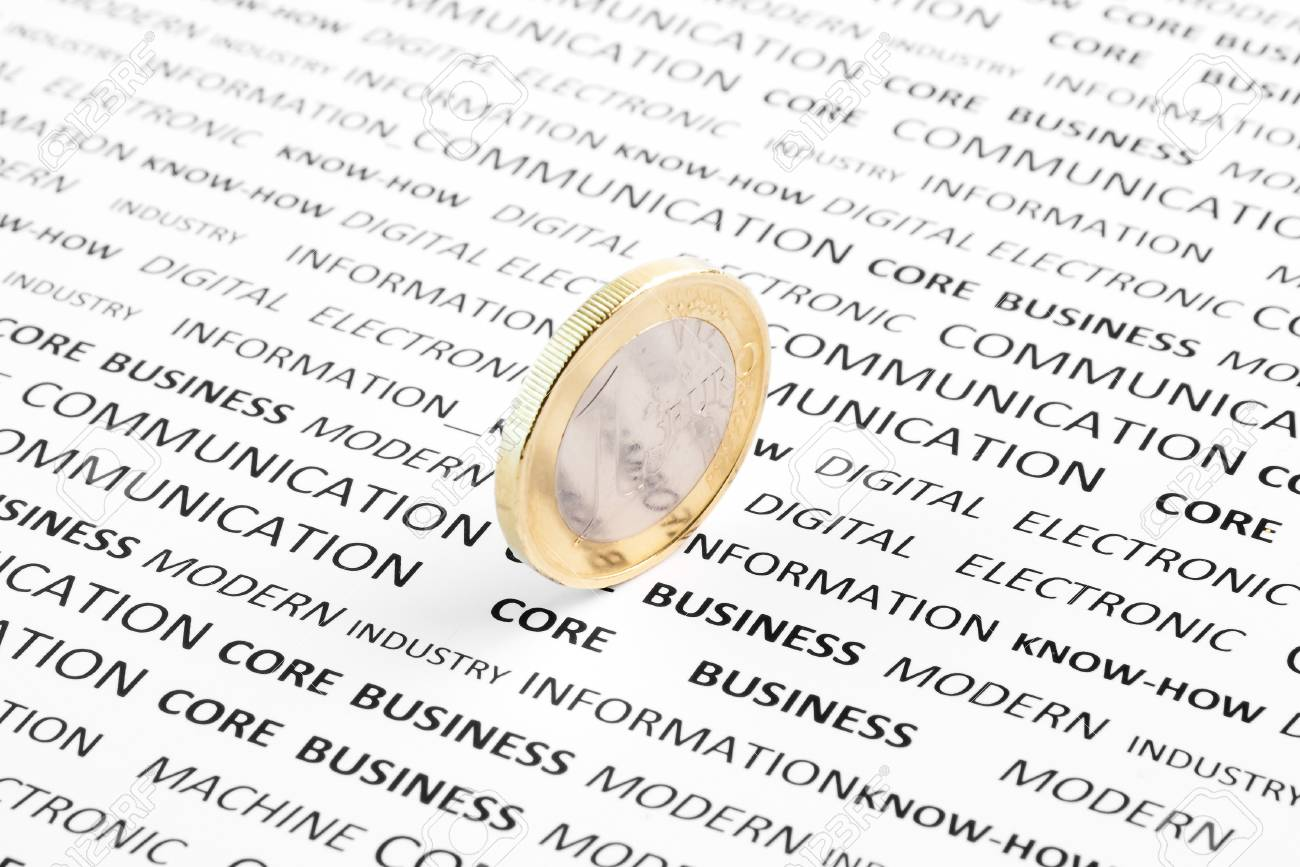 detail of euro coin on financial words Stock Photo - 12408700