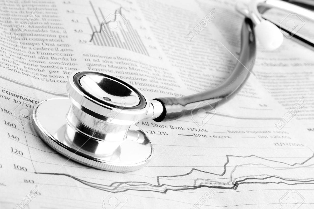 detail of a stethoscope on financial chart - 12711889