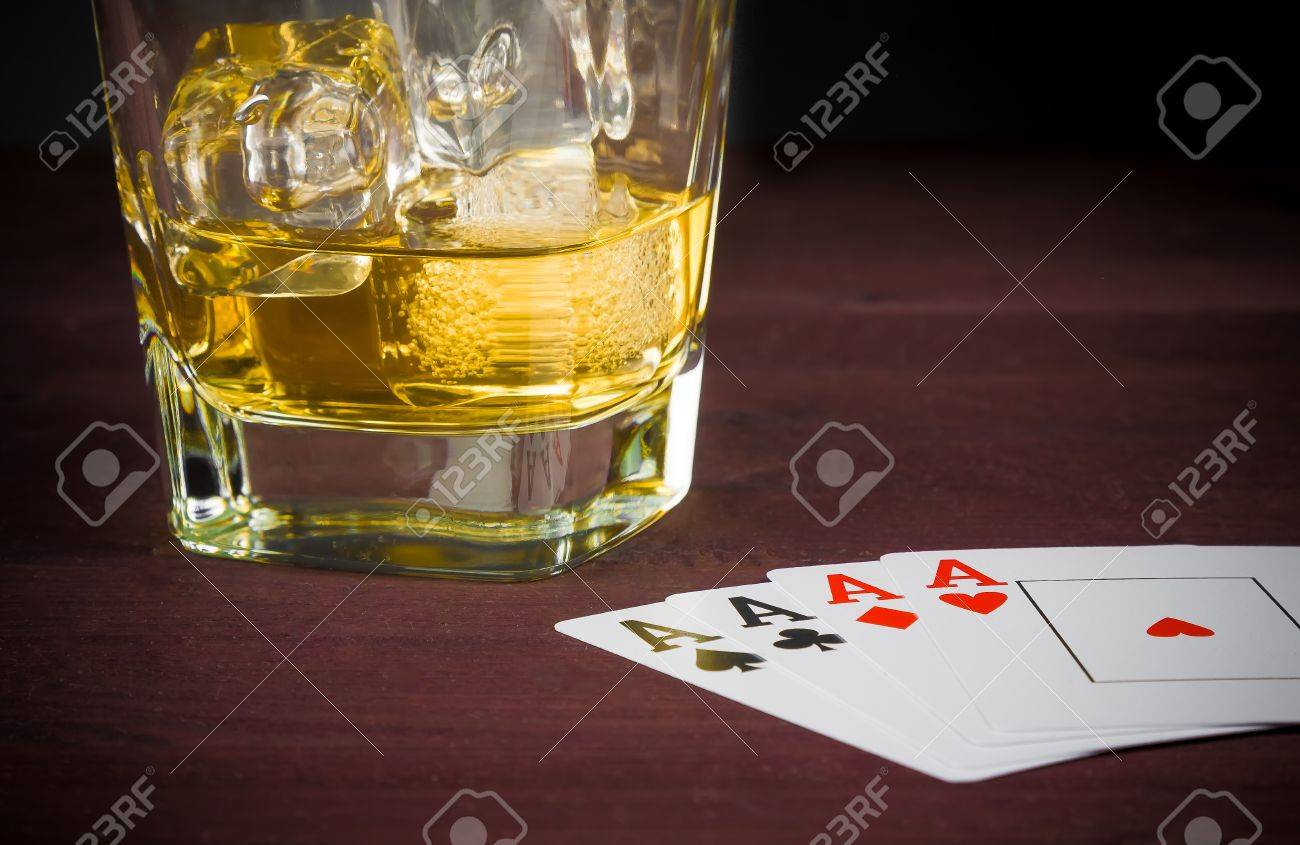 Superb Poker Playing Cards Near Wiskey Glass On Old Wood Table Home Remodeling Inspirations Basidirectenergyitoicom