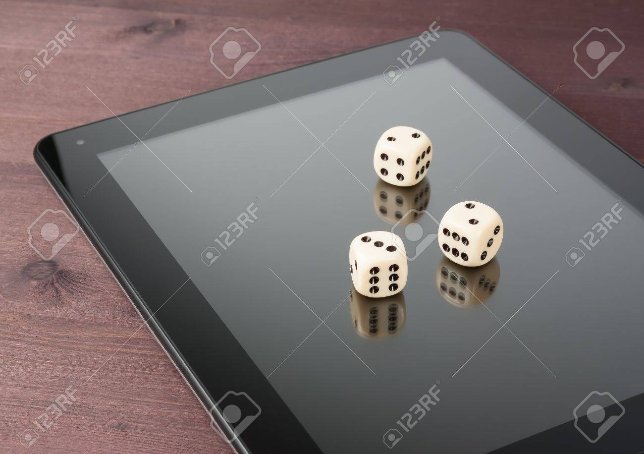 Dice On Digital Tablet Pc On Old Wood Table Concept Of Texas - Digital board game table