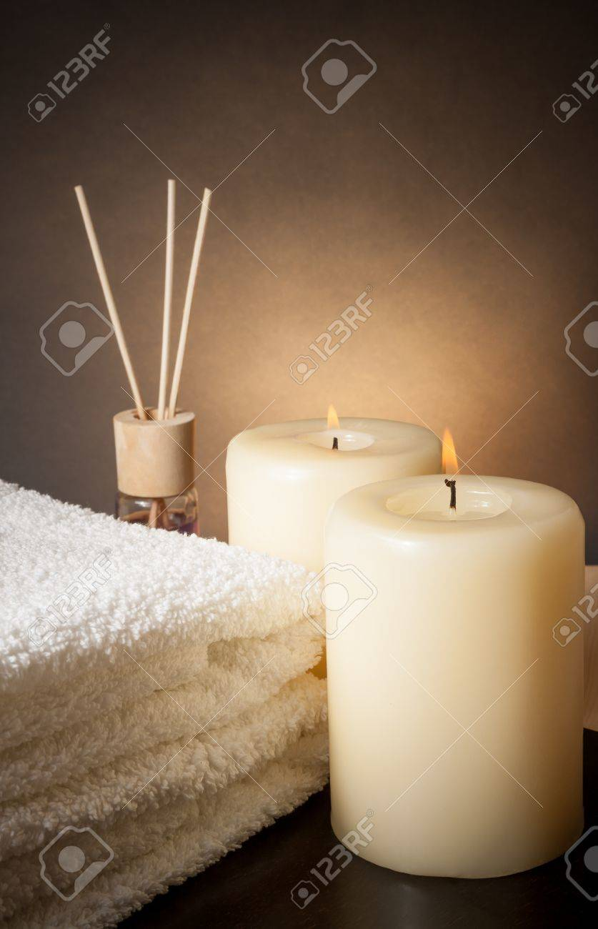 Spa massage border background with towel stacked and candles, with space for text - 29206741