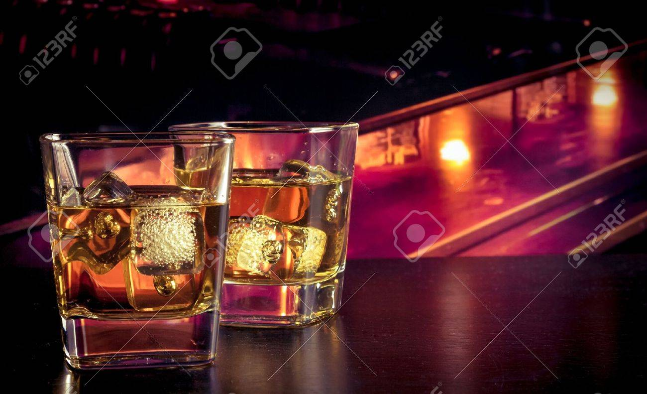 whiskey with ice on bar table lounge bar atmosphere - 31053760