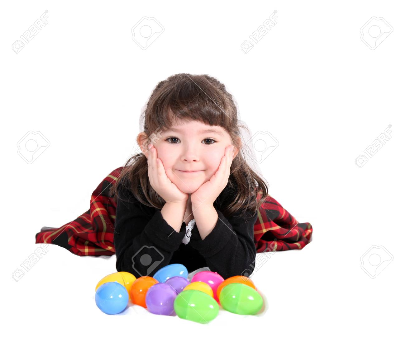 adorable girl lying with easter eggs isolated on white Stock Photo - 9427354