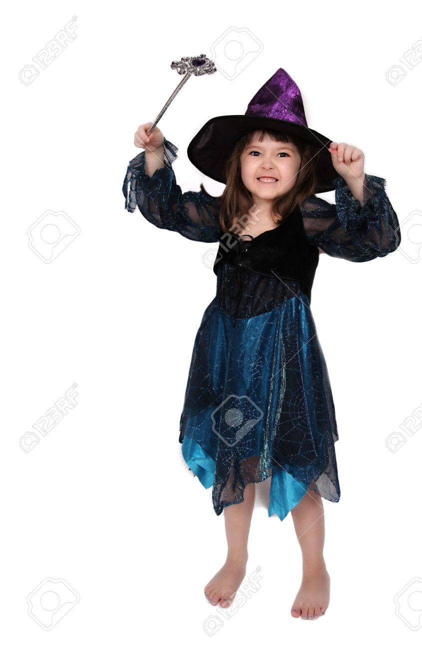 Adorable Little Girl Wearing A Fun Witches Costume. Isolated Stock ...