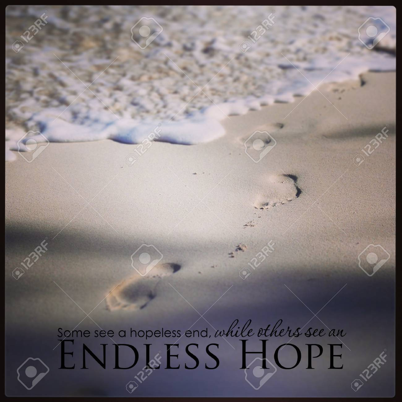 Footprints In The Sand With Inspirational Quote Stock Photo Picture