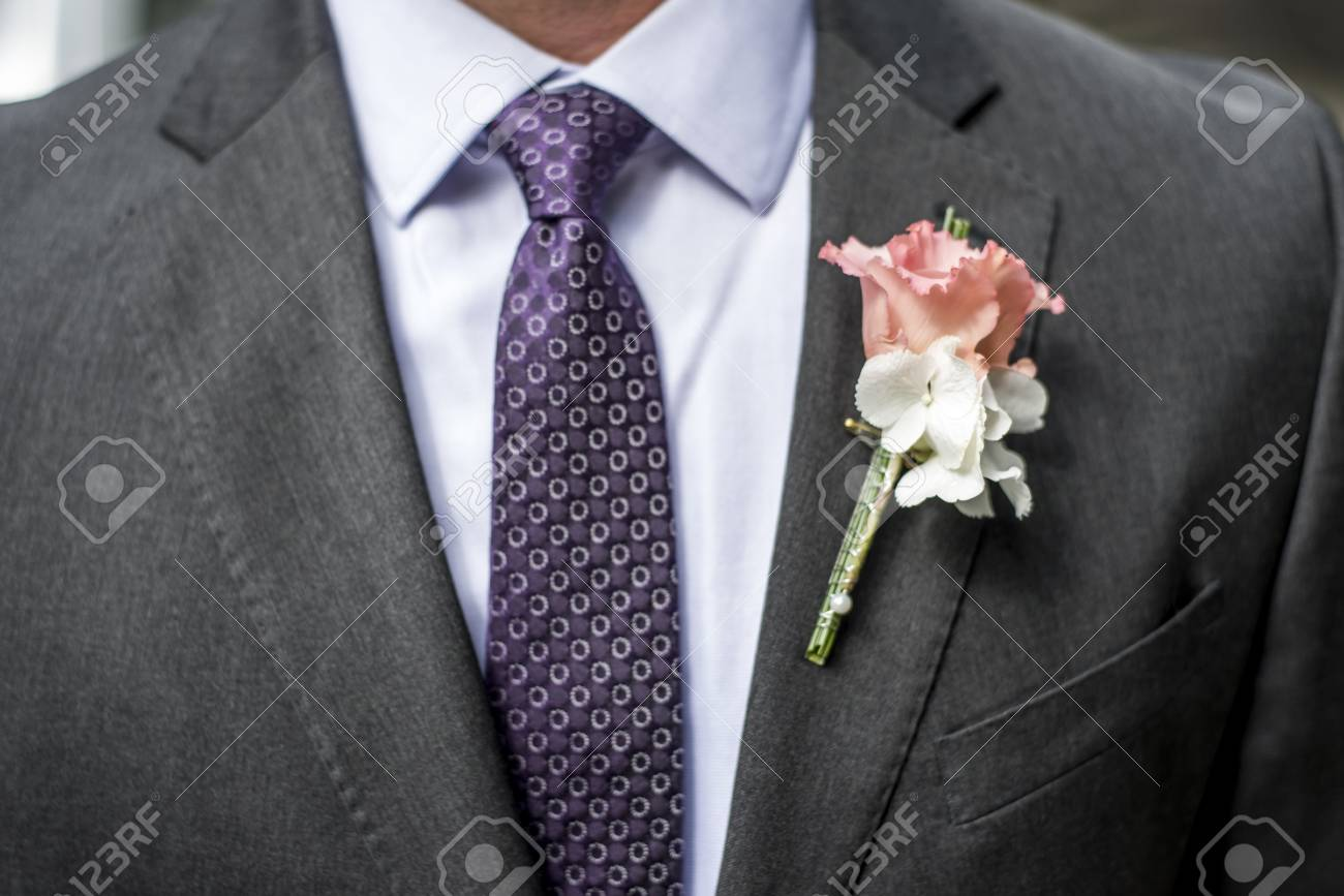504540096e6a Pink rose boutonniere flower groom wedding coat with tie shirt Stock Photo  - 79813119