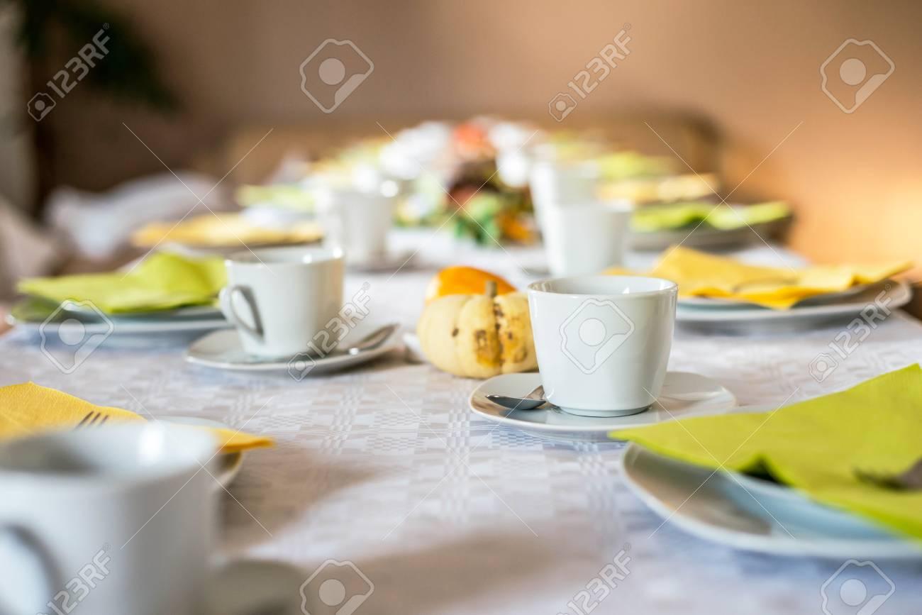 Beautiful festive dinner table colorful yellow fall helloween pumpkin decoration coffee mugs with saucers plates and & Beautiful Festive Dinner Table Colorful Yellow Fall Helloween ...