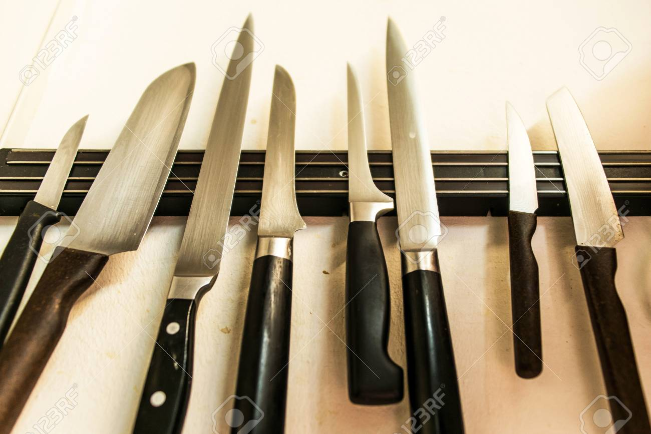 set of high quality kitchen cook knives tools on a magnet board..