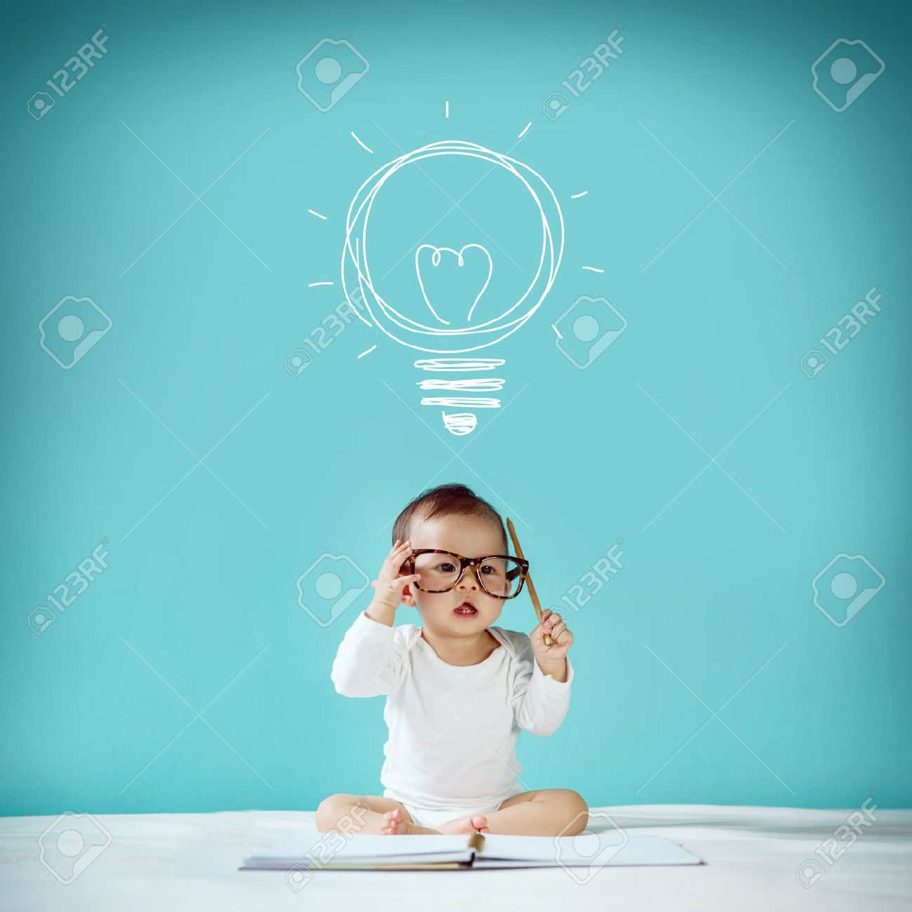 Concept idea of happy little baby with bulb at blackboard new family and love concept studio shot Stock Photo - 41415322