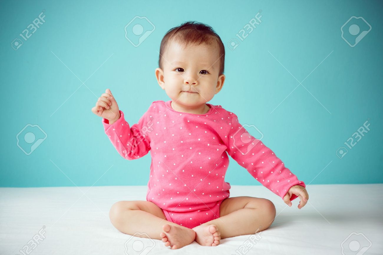 3099de943 Asian Baby Girl Wearing Pink Clothing Stock Photo