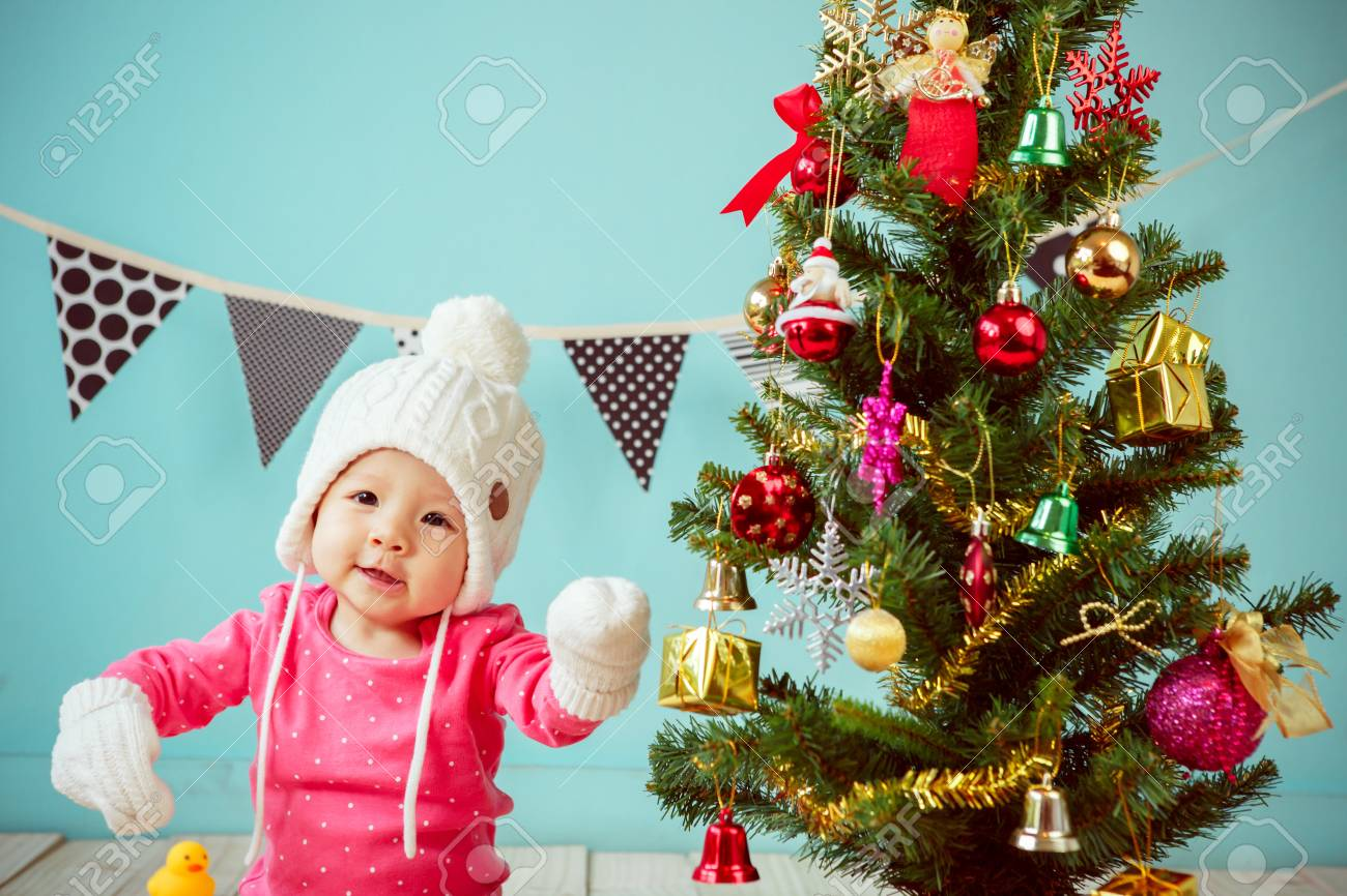 712d8f220 Asian Baby Girl Wearing Pink Clothing With Christmas Tree And Gifts ...
