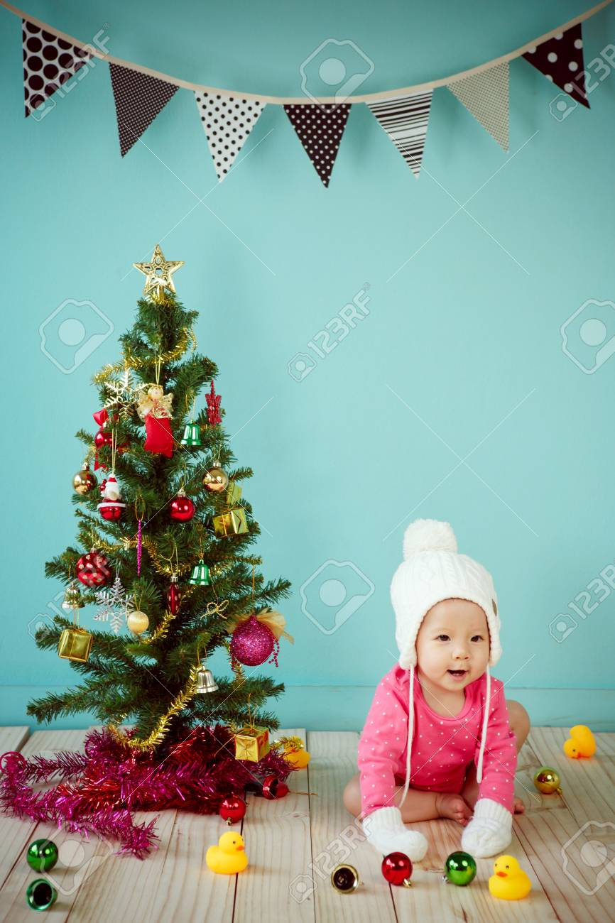 560d77d4a Infant Child With White Poodle Hat And Knitted Mittens And ...