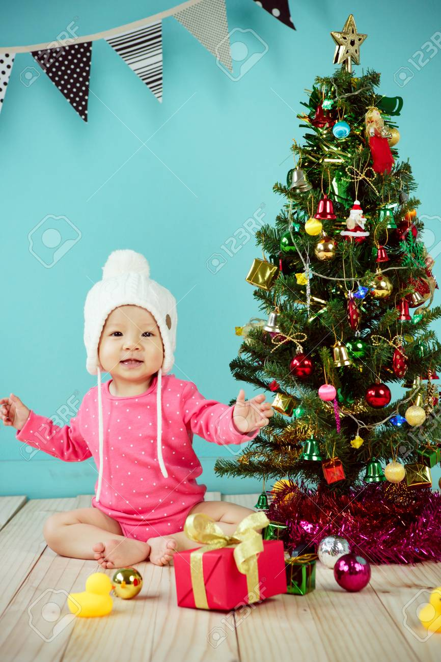 Baby Wearing White Knitted Beanie In Front Of Blue Background Stock Photo Picture And Royalty Free Image Image 42742676