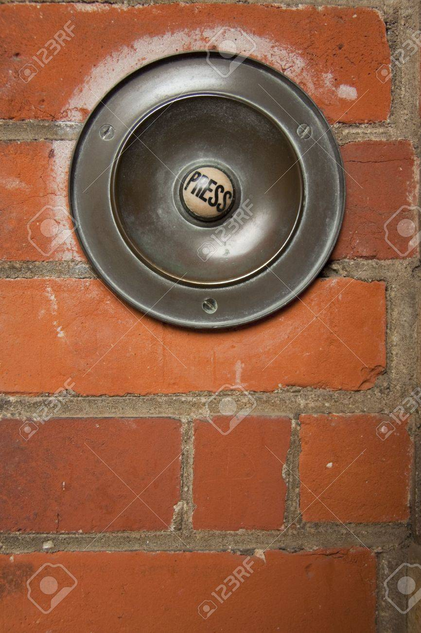 Large Old Fashioned Doorbell Mounted On Brick Wall With Button Marked Press  Stock Photo   6579260