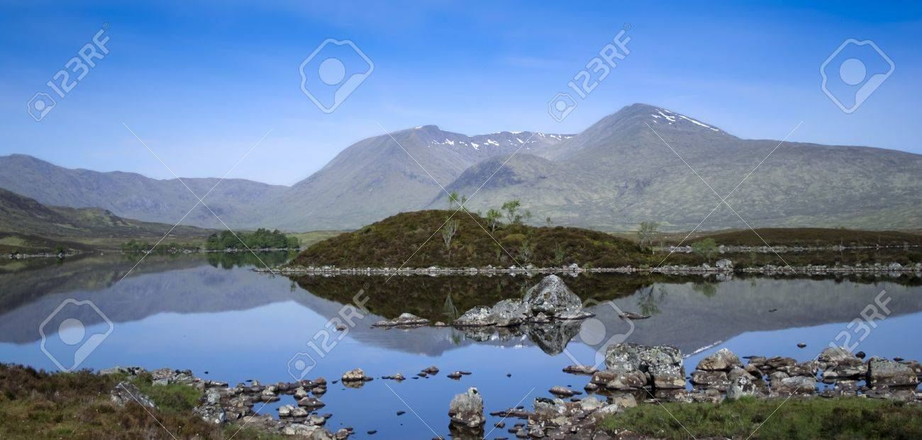 mountains reflecting in the still waters of lakes on rannoch moor in the scottish highlands Stock Photo - 7380617