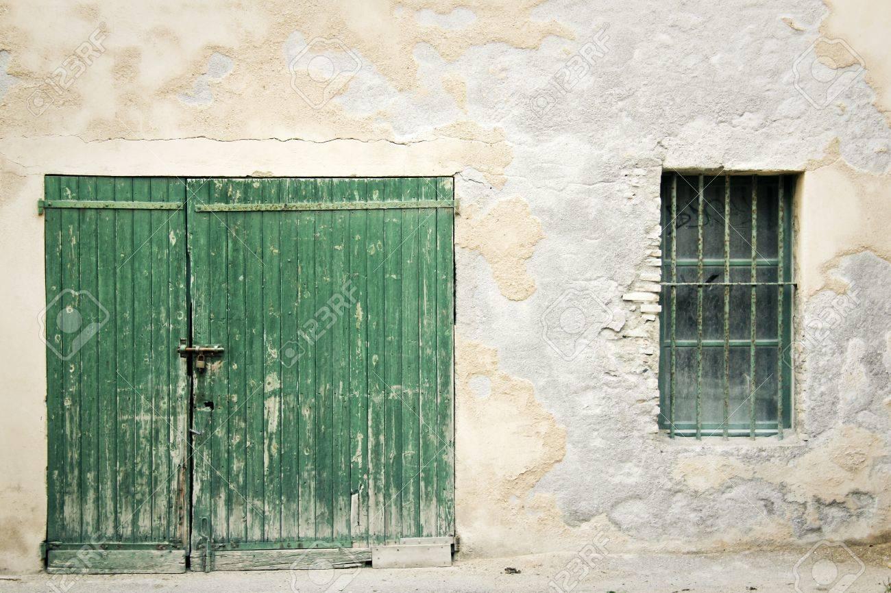 door padlocked: old green wooden door padlocked closed set in crumbling old wall with exposed & Door Padlocked Images \u0026 Stock Pictures. Royalty Free Door ... Pezcame.Com