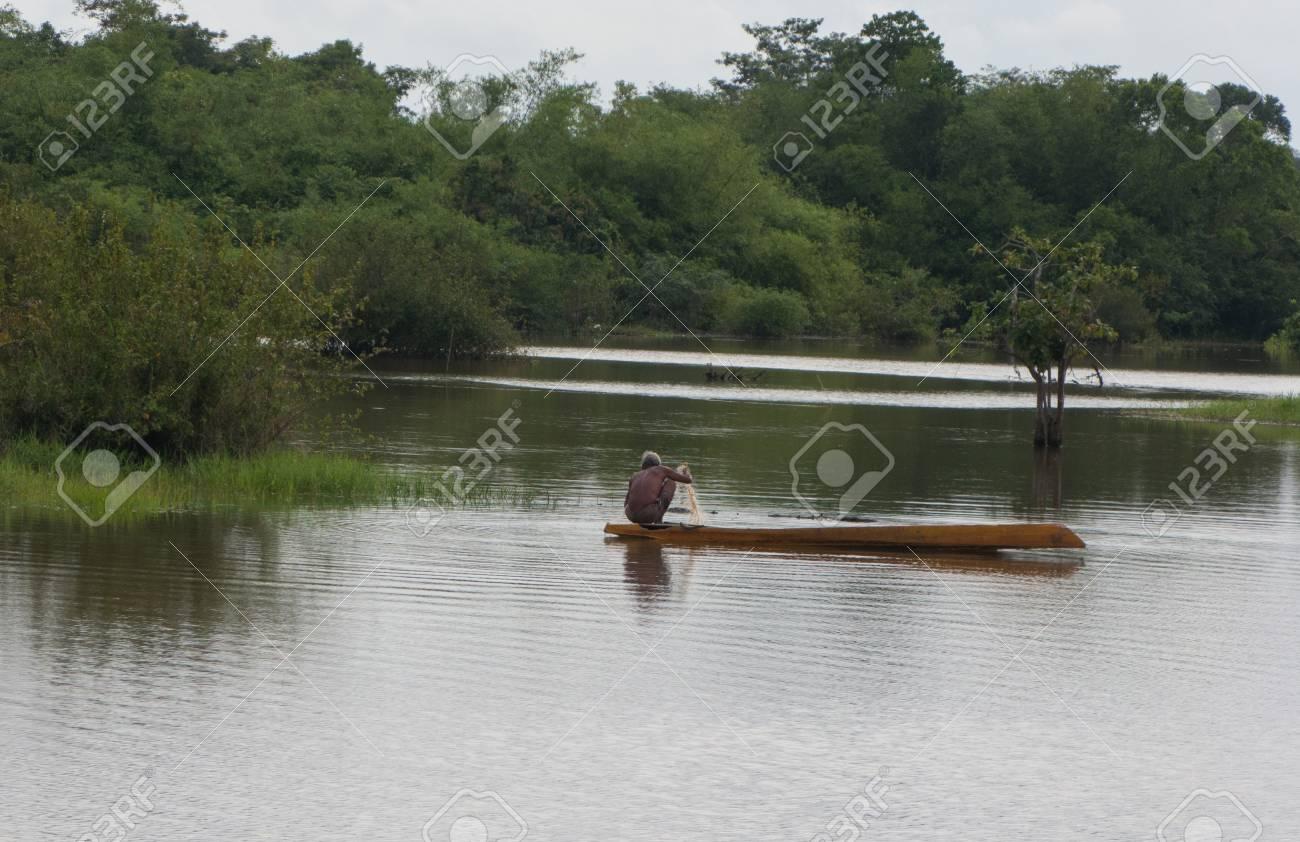 Fisherman catch fish on boat Stock Photo - 14315953