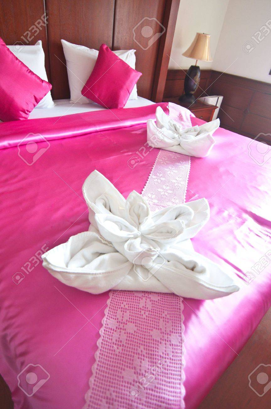room in a hotel with a decoration of the towel flowers on the bed stock photo