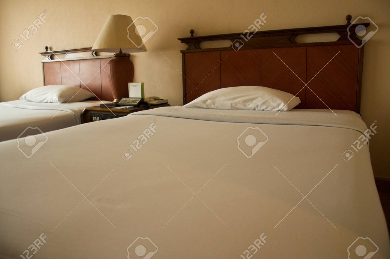 Two beds bedroom with bedside table and lamp Stock Photo - 20419416