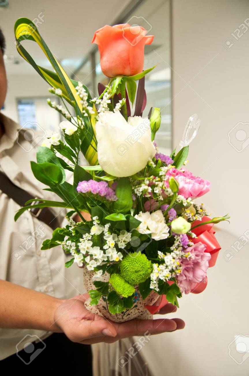 Close Up Of Man\'s Hand Giving Bouquet Of Flowers Stock Photo ...