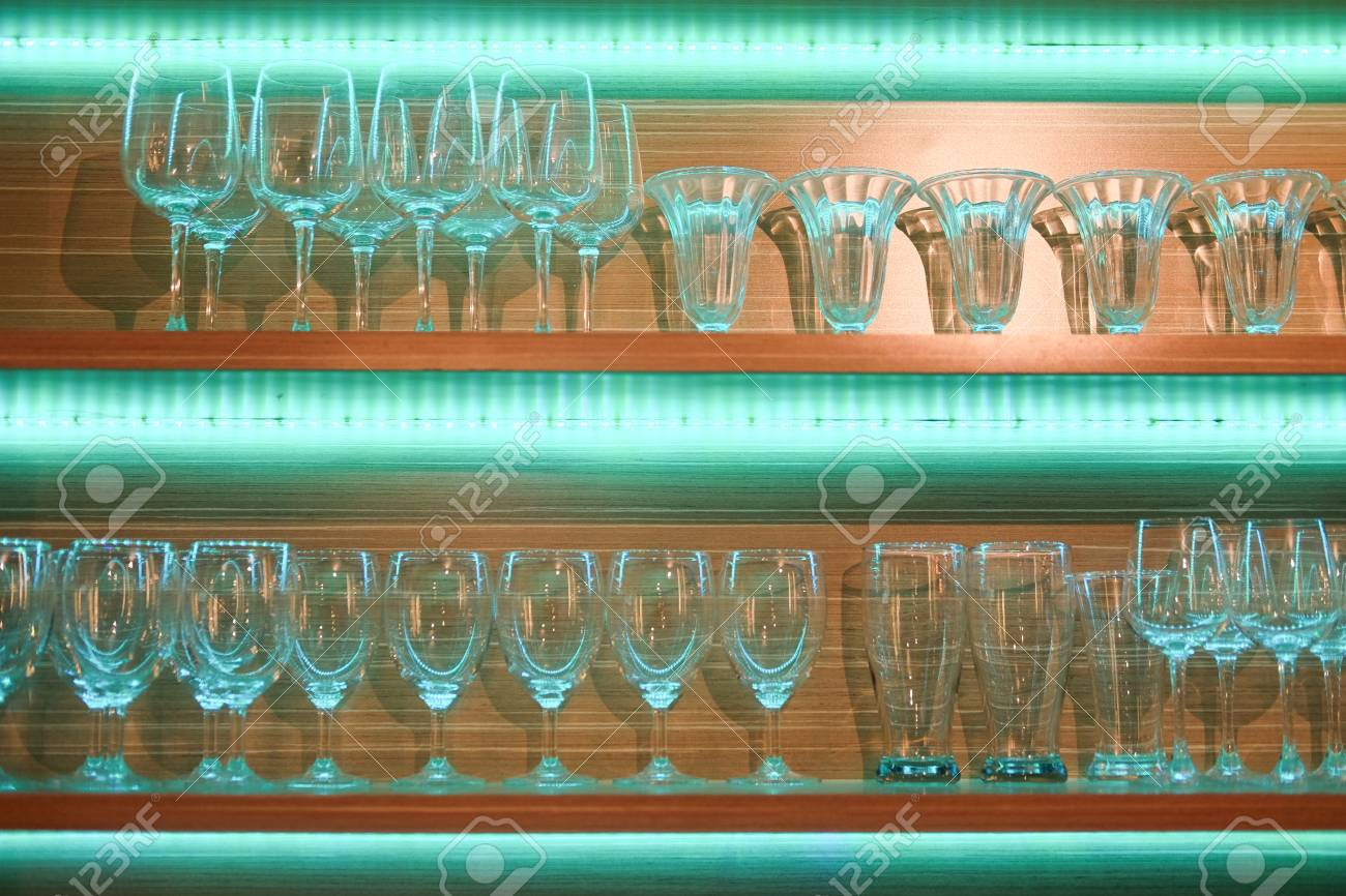 Display Counter With Various Glass In Bar At Night Background ...
